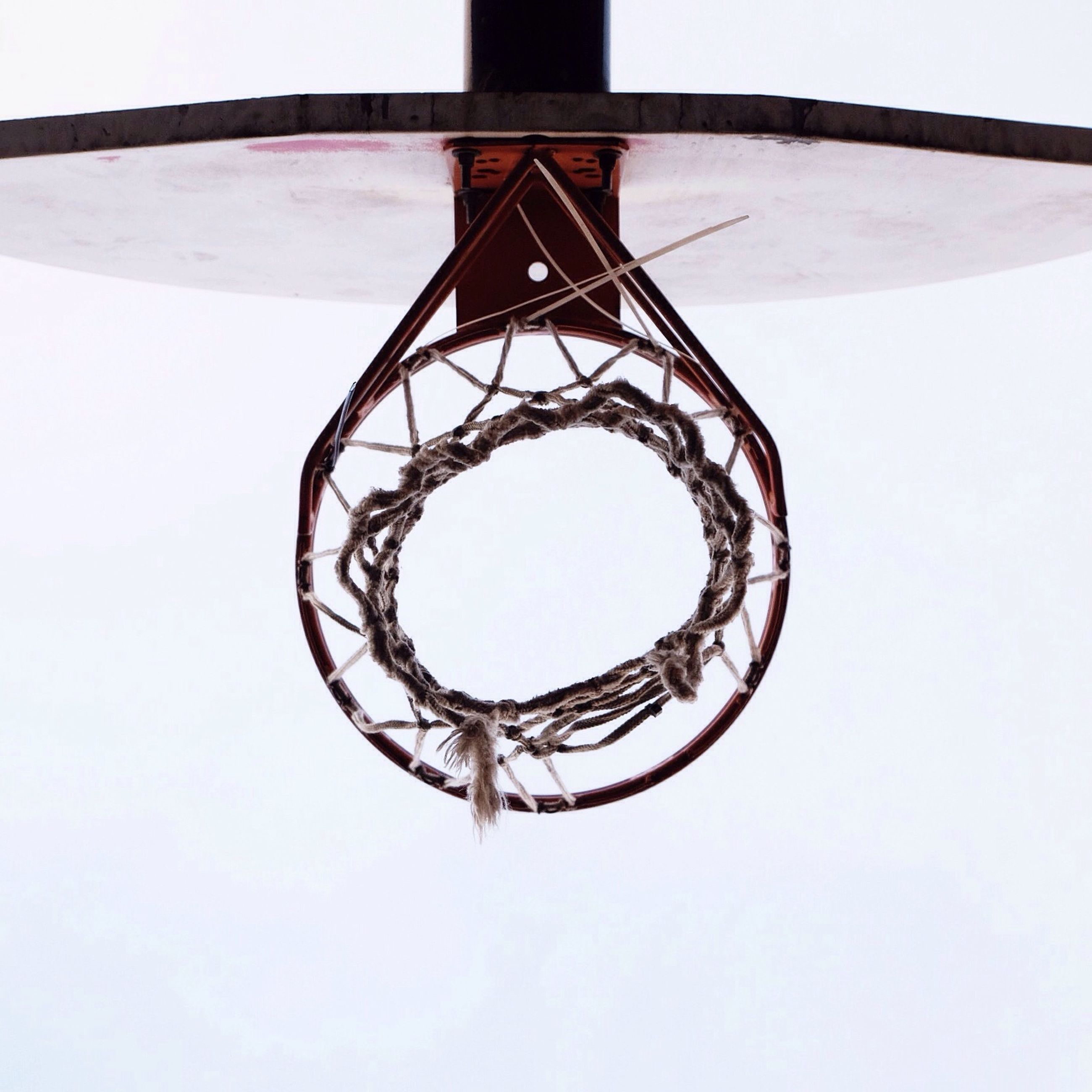 low angle view, built structure, circle, architecture, geometric shape, directly below, metal, design, clear sky, spiral, pattern, shape, day, indoors, spiral staircase, metallic, no people, basketball hoop, sky, close-up