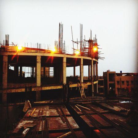 Construction Taking Photos Dusk In Rust, We Trust