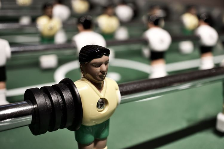 Close-up of figurine on foosball