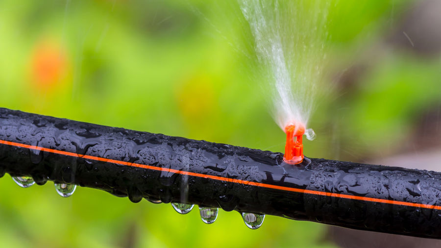 Close-up of water drops on metal pipe