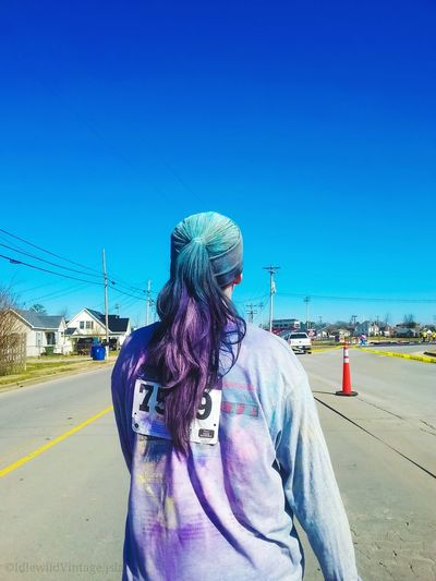 """""""Run For Their Lives-Color Run Young Women Young Woman Long Hair Picofday Street Photo Color Run 5k Run Charity Run Shot From Behind Rainbow Colors Beautiful Mess Running The Portraitist - 2018 EyeEm Awards Blue Portrait Women Sky Head And Shoulders Pretty Beautiful Woman Pink Hair Powder Paint Tousled Hair EyeEmNewHere"""