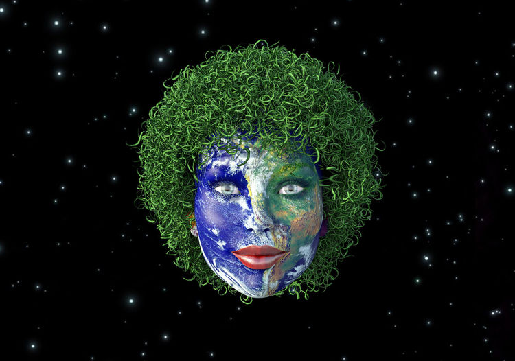 Digital composite image of human face painted as globe against star field