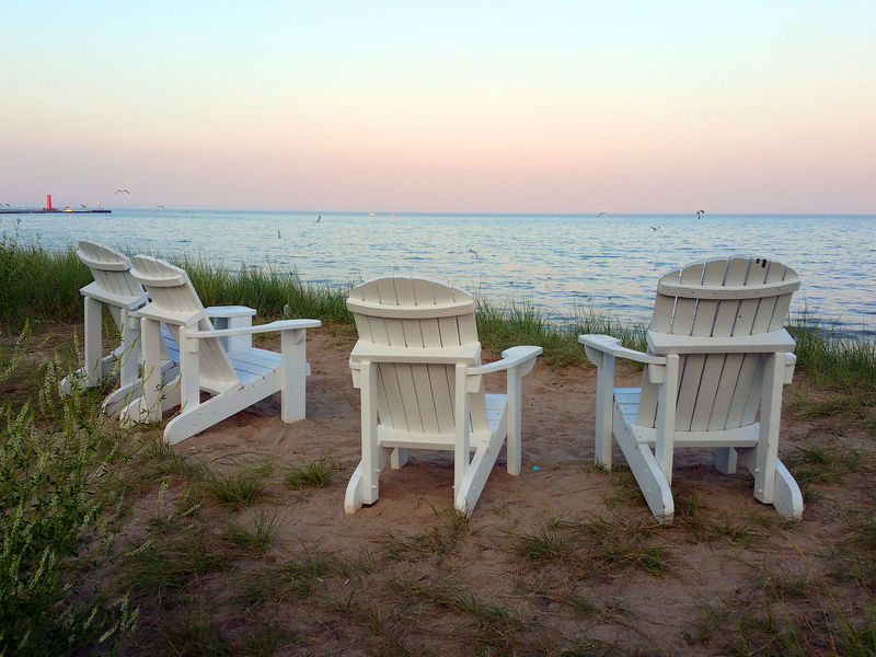 Beach chairs overlooking the water Absence Beach Beach Chairs Beauty In Nature Blue Calm Day Empty Four Grass Horizon Over Water Nature No People Non-urban Scene Ocean Outdoors Remote Scenics Sea Shore Sky Tranquil Scene Tranquility Travel Destinations Water