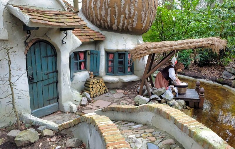 Attraction theme park the Efteling, Kaatsheuvel, the Netherlands. Architecture Day Built Structure Building Exterior Nature Tree House Plant Building Men Adult Sitting People Outdoors Real People Togetherness Two People Women Water Males