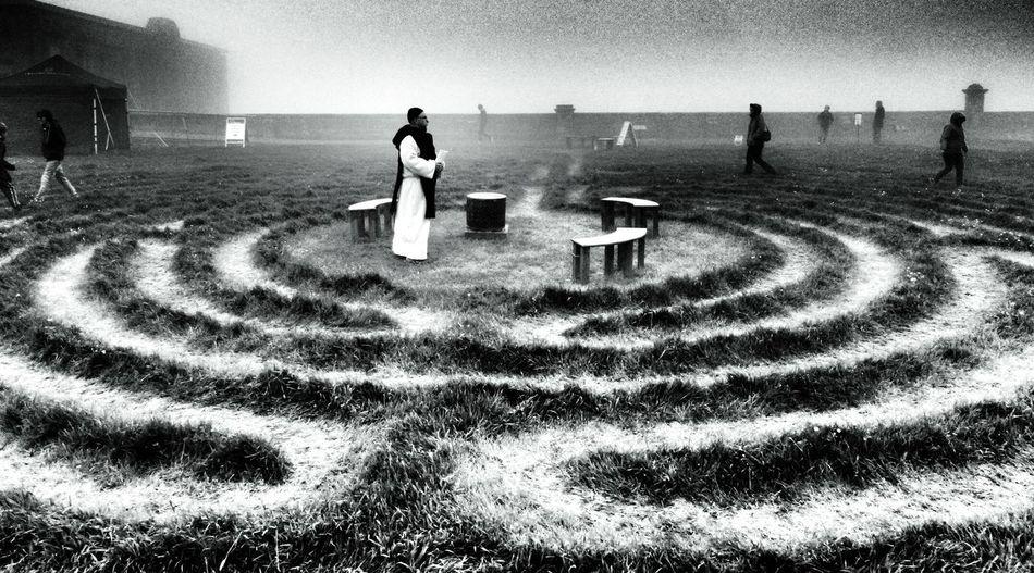 Priest Praying On Labyrinth Field