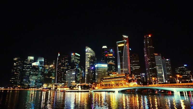 Adapted To The City Architecture Illuminated Building Exterior Night City Built Structure Skyscraper River Modern Waterfront Water Clear Sky Tower Urban Skyline Cityscape No People Sky