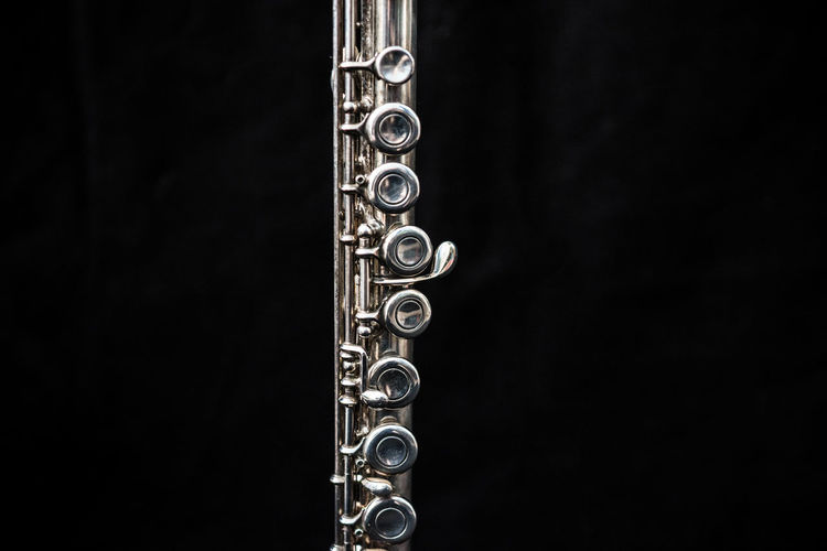 A transverse flute standing. Music Shiny Standing Black Background Close Up Close-up Flute Long Metal Metallic Music Musical Equipment Musical Instrument No People Silver  Studio Shot Transverse Flute Transvestite Wind Instrument