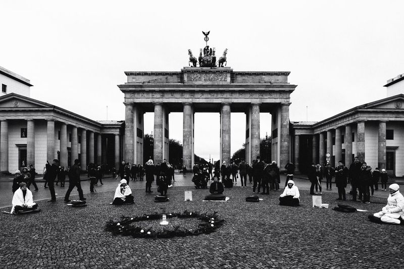 Architecture Built Structure Travel Destinations Reportage Meditation Real People Travel Building Exterior Outdoors History Statue City Gate Sculpture Sky Day City People Capture Berlin Berlin Germany Brandenburg Gate Christmastime Monochrome Blackandwhite Candid Resist