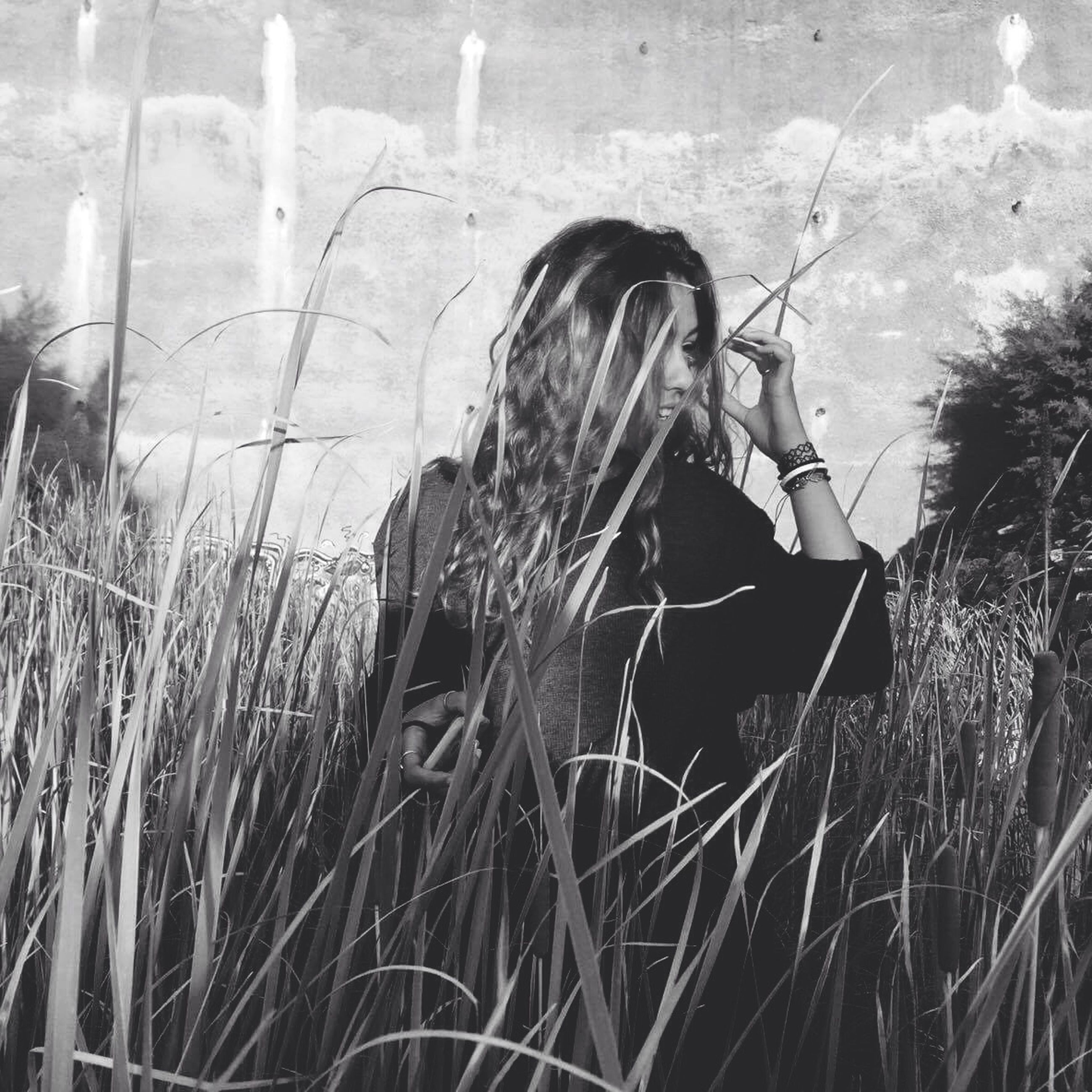 grass, plant, growth, person, field, outdoors, day, wind, in front of