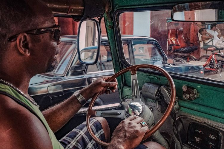 Taxidriver Havana Havanna, Cuba Taxi Taxidriver Driving Oldcar Street Photography Street Light Cuba Cuba Collection Transportation Car Mode Of Transport Steering Wheel One Person Car Interior Sitting EyeEmNewHere Stories From The City Adventures In The City Focus On The Story The Street Photographer - 2018 EyeEm Awards The Street Photographer - 2018 EyeEm Awards