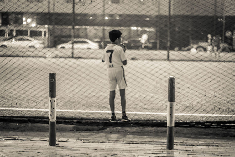 Baseball - Sport Baseball Bat Baseball Player Chainlink Fence Childhood Children Only Court Day Fence Full Length Kid One Person Outdoors People Playing Playing Games Popular Photos Protective Sportswear The Week On Eyem Adapted To The City Soccer Soccer Player Sport Standing Sunlight