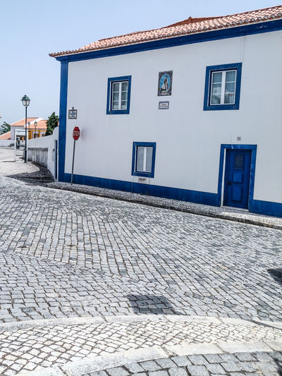Portugal. EyeEm ZOOM it to see details... Typical Haus Colors... Architecture Blue Building Building Exterior Built Structure City Cobblestone Day Footpath House Nature No People Outdoors Pattern Paving Stone Street Town White Color Window