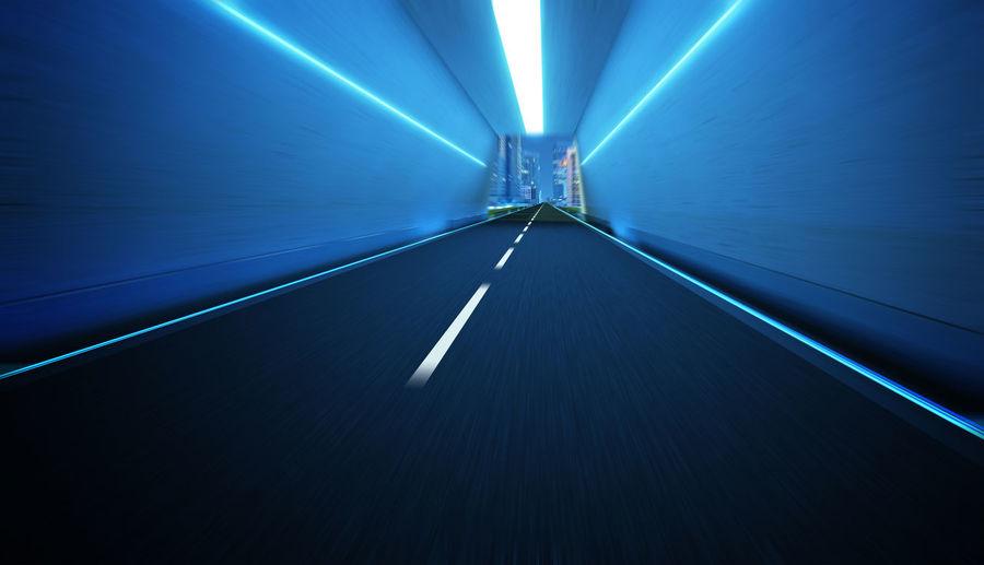 Illuminated Tunnel In City At Night