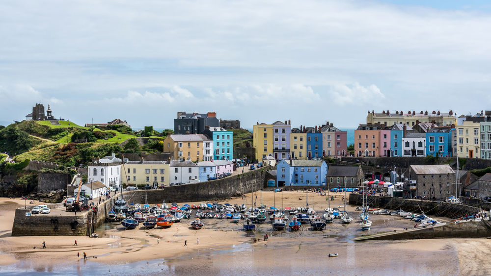 The pretty seaside town of Tenby at low tide Fishing Boats Harbour Harbour View Holiday Summertime Tenby Architecture Beach Building Exterior Cloud - Sky Day Feel Good Low Tide Outdoors Sailing Boats Seaside Town Sky Tenby, Pembrokshire Tourist Destination Travel Destinations