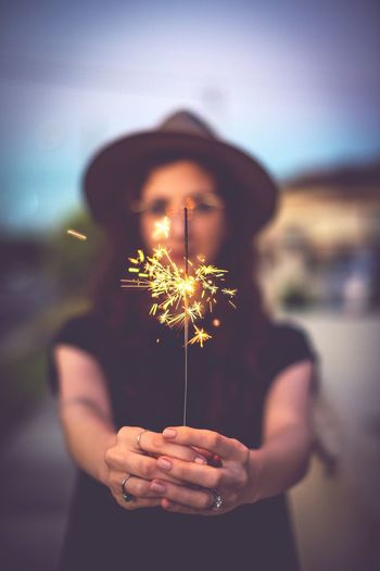 Spark an idea Holding One Person Focus On Foreground Illuminated Real People Front View Hand Adult Human Body Part Leisure Activity Sparkler Women Close-up Plant Waist Up Human Hand Celebration Sparks Lifestyles EyeEmNewHere