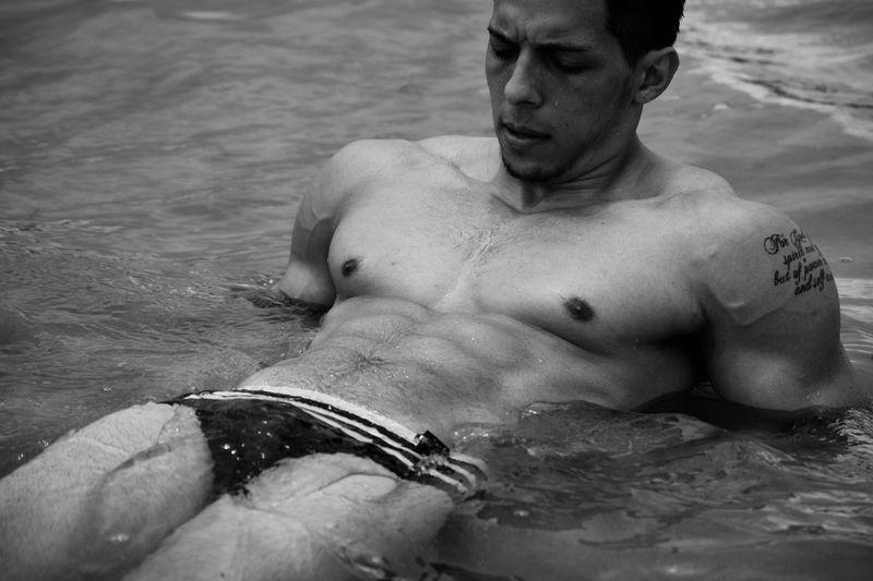 Young Shirtless Athlete Swimming In Lake