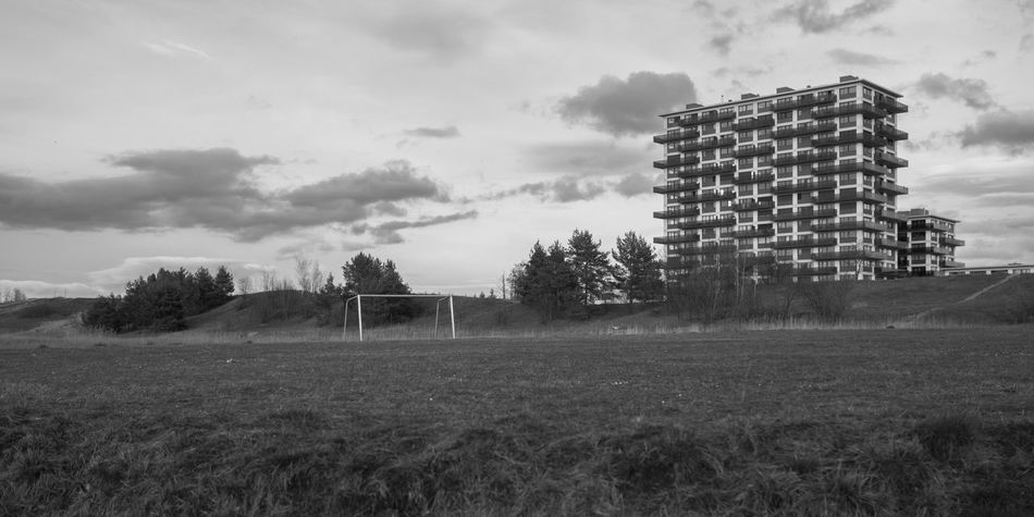 arm aber sexy: Zürich Appartment Block Black And White Building Exterior Built Structure Cloud - Sky Day Field Football Football Field Football Goal Housing Estate Nature No People OlympusPEN Outdoors Schweiz Sky Tree Olympus Pen-f Olympus Zürich