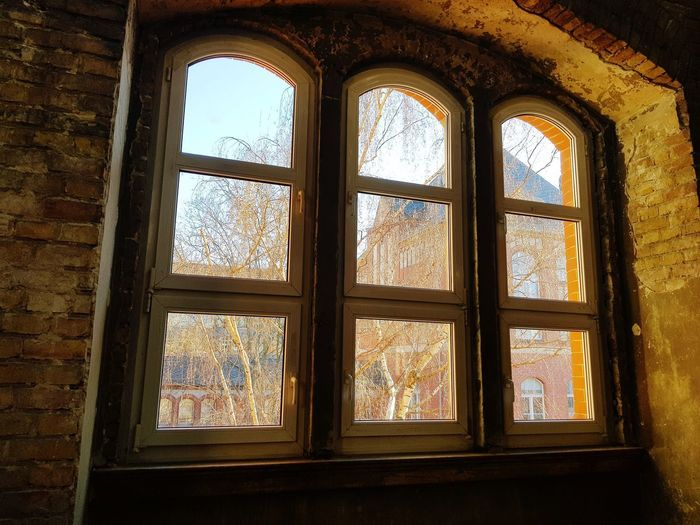 View through Window History Golf Club Architecture Built Structure Window Frame Stained Glass Window Sill Looking Through Window Window Box Shattered Glass Transparent Frame Historic Architectural Feature Skylight