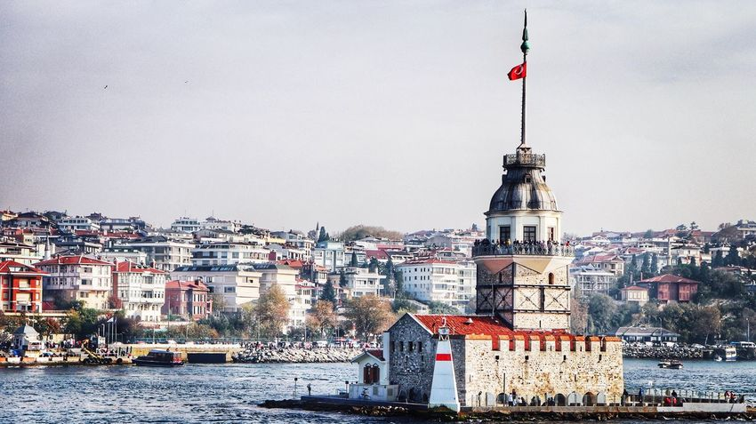standing alone with all her beauty Bosphorus Maiden Tower Kız Kulesi Istanbul Sea Building Exterior Flag Architecture City Red Cityscape Travel Destinations History Sky Outdoors No People Built Structure Day First Eyeem Photo EyeEmNewHere The Graphic City Mobility In Mega Cities Adventures In The City
