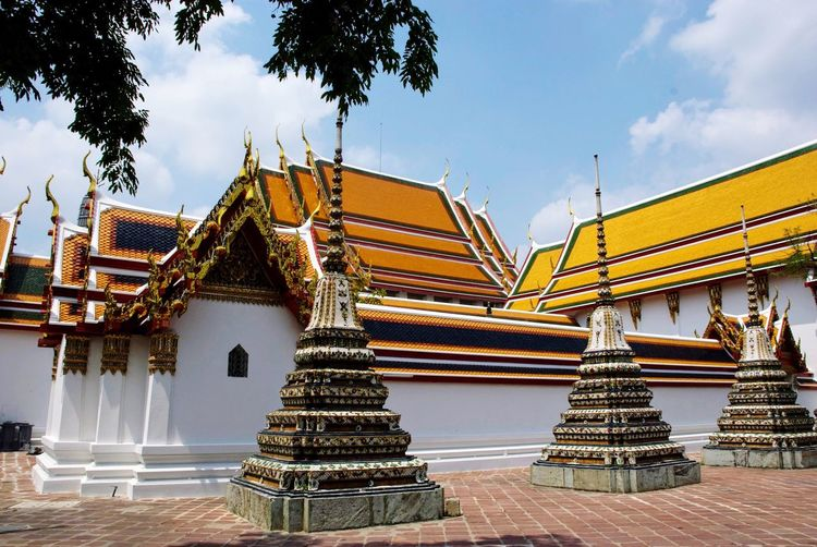 Ornamented towers of buddhist temple wat pho in bangkok, thailand