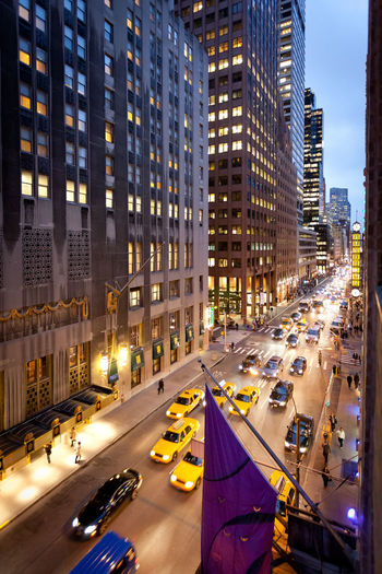New York street life New York Yellow Cabs Architecture Building Exterior Built Structure City City Life City Street Cityscape Downtown District High Angle View Illuminated Modern Night Outdoors Road Skyscraper Street Traffic Transportation Urban Skyline EyeEmNewHere