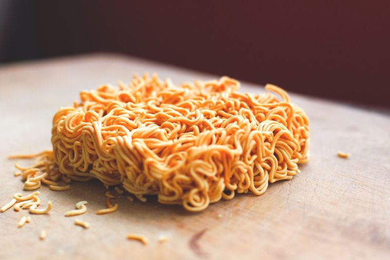Close-up of raw noodles on table