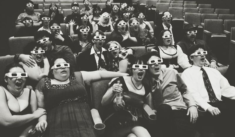 Arts Culture And Entertainment Sitting Crowd Watching Audience Cheering Women Spectator Men Adult People Togetherness Large Group Of People Indoors  Film Industry Adults Only 3D Glasses  Movies Movie Theater Theater Performance Performing Arts Art Music Culture