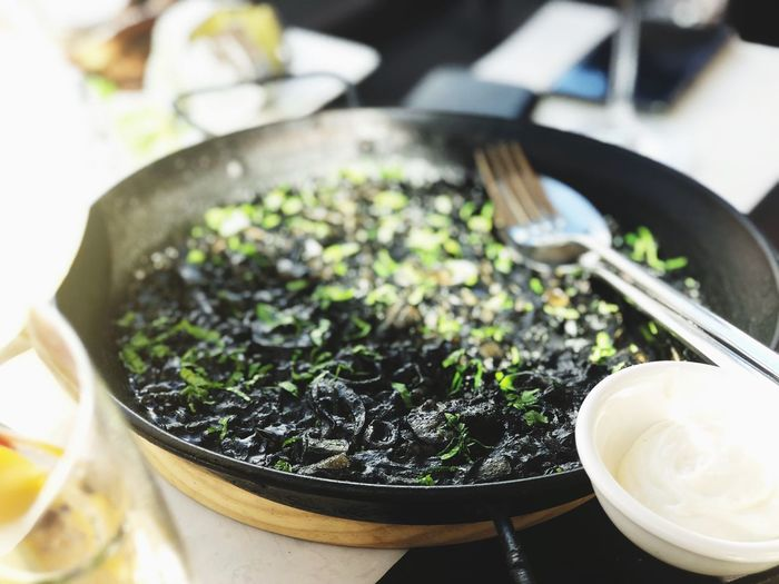 Squid ink paella 😍 Yummy Barcelona Paella! Squidink Food And Drink Food Indoors  No People Freshness Close-up Ready-to-eat