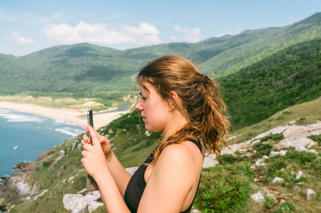 Beautiful Woman Beauty In Nature Brazil Day Florianópolis Hiking Holding Leisure Activity Lifestyles Mountain Mountain Range Nature One Person Outdoors Pantano Do Sul People Praia Do Matadeiro Real People Scenics Side View Sky Tree Water Young Adult Young Women