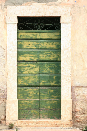 Antique Architecture Architecture Building Exterior Building Exterior Architecture Built Structure Close-up Closed Day Door Doorstep Entrance Facade Building Frame Green Italian Italy Medieval No People Old Outdoors Painted Shut Stone Wooden