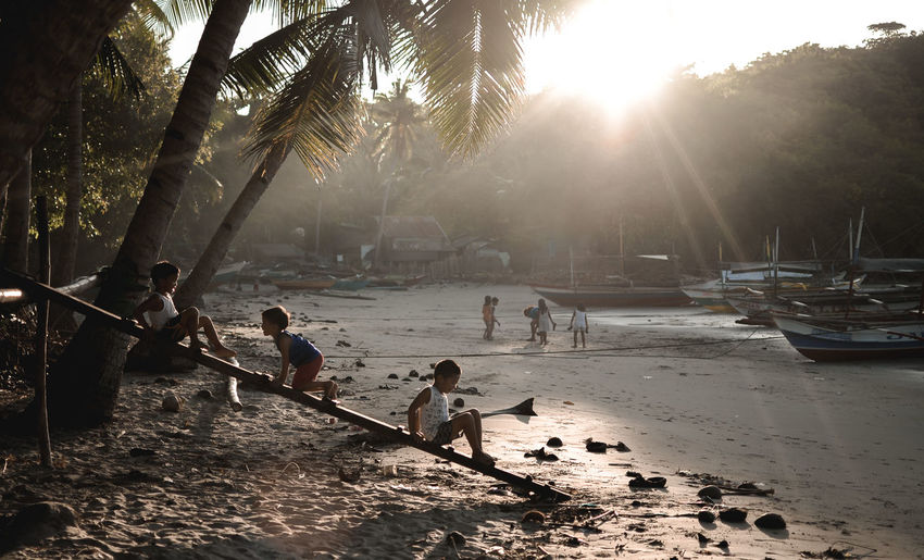 better place. #Instagram #photography Instagood Instamood Picture Negros Occidental Life Is A Beach Life Events Lifeisbeautiful Lifephotography Lifestyles Tree Water City Sunlight Silhouette Sun Light Beam Beach Men Sunbeam