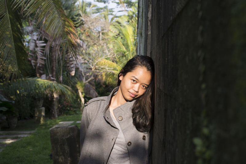 location scouting with the talented immanalia Bali Copy Space Indonesian Millenials Palm Tree Portrait Of A Woman Stylish Asian Girl Cover Photo Cute Fashion Model Front View Hero Image Leisure Activity Lifestyles One Person Pretty Real People Smiling Southeast Asia Standing Young Adult