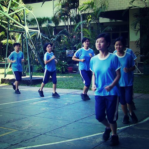 girls running High School Life People SMA Trinitas School Uniform