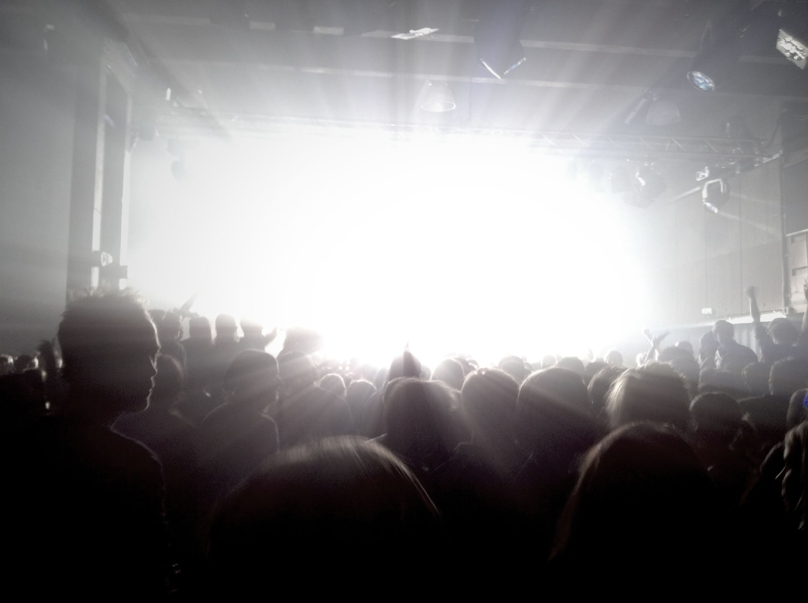 lifestyles, leisure activity, lens flare, large group of people, sunbeam, men, sun, person, sunlight, enjoyment, indoors, togetherness, crowd, fun, brightly lit, silhouette, bright, back lit, light - natural phenomenon
