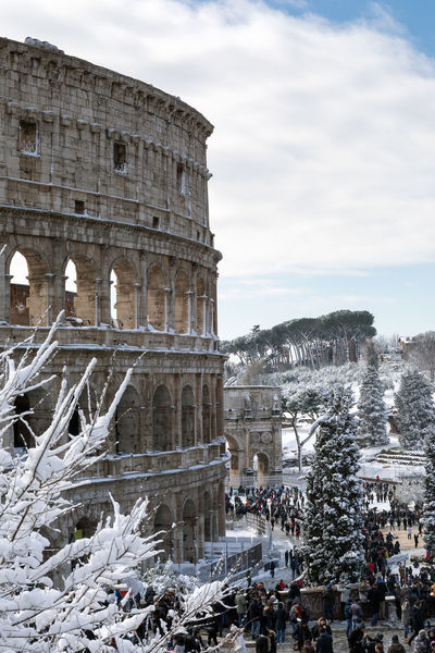 Rome, Italy - February 26, 2018: An exceptional weather event causes a cold and cold air across Europe, including Italy. Snow comes in the capital, covering streets and monuments of a white white coat. In the photo, the Colosseum covered by snow. Winter Ancient Ancient Civilization Architecture Building Exterior Built Structure Cloud - Sky Cold Temperature Colosseum Day History Large Group Of People Monument Old Ruin Outdoors People Real People Sky Snow Snowing Day The Past Tourism Travel Destinations White Winter