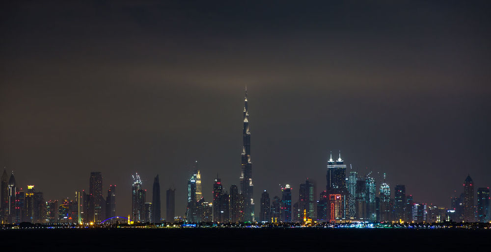 From Across Building Exterior Architecture Night Built Structure City Tall - High Sky Illuminated Building Skyscraper Office Building Exterior Tower Landscape Cityscape Modern Urban Skyline Travel Destinations No People Nature Financial District  Spire  Outdoors