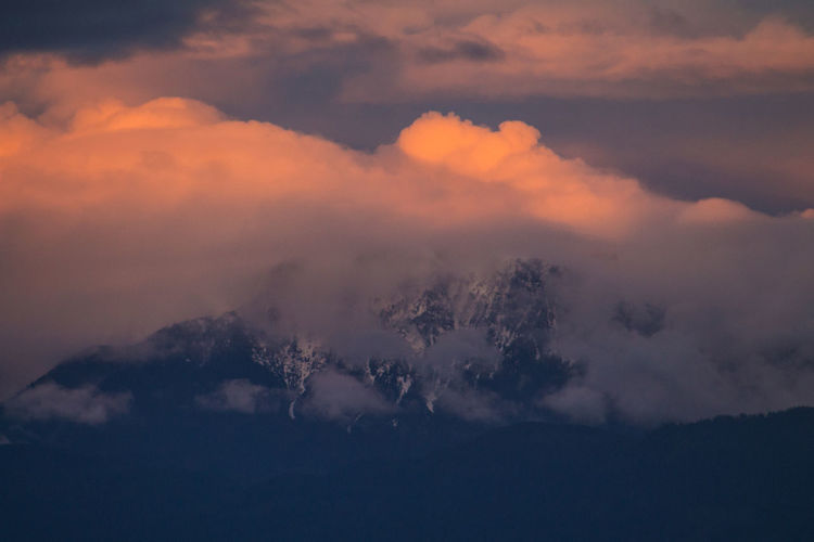 Snowcapped Mountain Buried in Clouds Atmosphere Atmospheric Mood Cloud Cloud - Sky Cloudscape Cloudy Dramatic Sky Majestic Moody Sky Outdoors Overcast Scenics Silhouette Sky Snowcapped Snowcapped Mountain Storm Cloud Sunset Tranquil Scene Weather