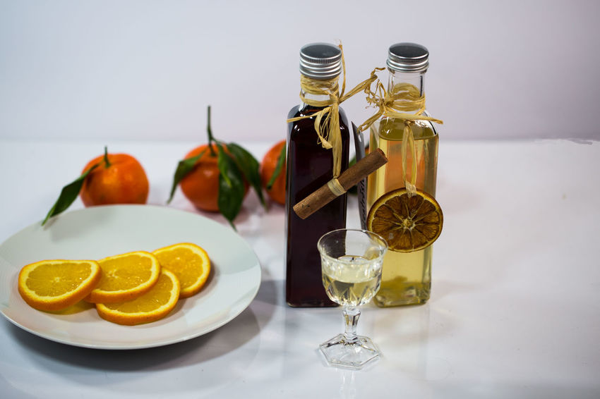 Liqueur Food And Drink Food Still Life Citrus Fruit Table Fruit Freshness Refreshment Healthy Eating Lemon Plate Indoors  Glass No People Drink Wellbeing Ready-to-eat Container Drinking Glass Bottle Orange