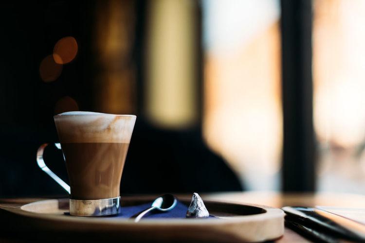 Beautiful setting of cappuccino near window.