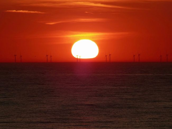 Sunset Sun Orange Color Sky Scenics - Nature Sunlight Beauty In Nature Tranquil Scene Tranquility Renewable Energy Environmental Conservation