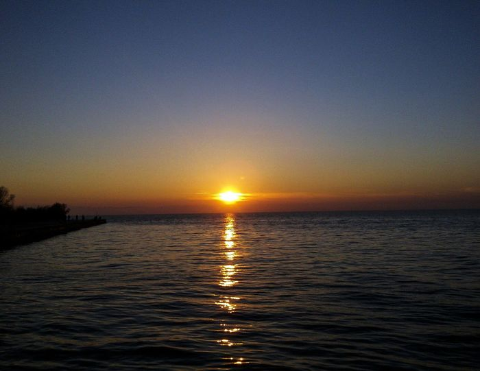 Sunset Water Sea Tranquility Beauty In Nature Reflection Sky Tranquil Scene Scenics Nature Horizon Over Water Outdoors No People Sun Day Sea And Sky Beauty In Nature Nature Photography Natureporn Mothernature Landspace Sunset_collection