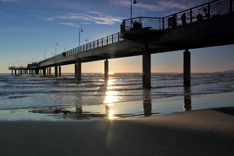 The pier of Marina di Pietrasanta Piercing Travel Architectural Column Architecture Beauty In Nature Bridge Bridge - Man Made Structure Built Structure Cloud - Sky Connection Day Horizon Over Water Nature No People Outdoors Scenics Sea Sky Sunlight Sunset Transportation Vacation Water