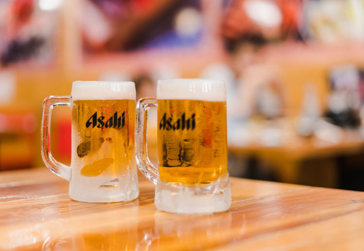 Alcohol Asahi Bar Beer Beverage Brand Brewery Celebrate Chill Cold Company Dinner Drink Foam Frost Glass Gold Illustrative Editorial Japan Label Lager Light Logo Mug Night Party Pour Relax Restaurant Serve Trademark Yellow
