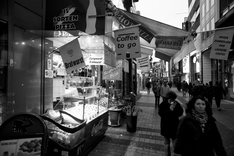 Shopiping at Cologne Schildergasse. Night Illuminated City Building Exterior Nightlife Men Leisure Activity Architecture Large Group Of People Outdoors People Adult Germany Streetphotography Black & White Black And White Blackandwhite Monochrome Cityscapes City Life Urban City Street Street Photography Street Black And White Photography