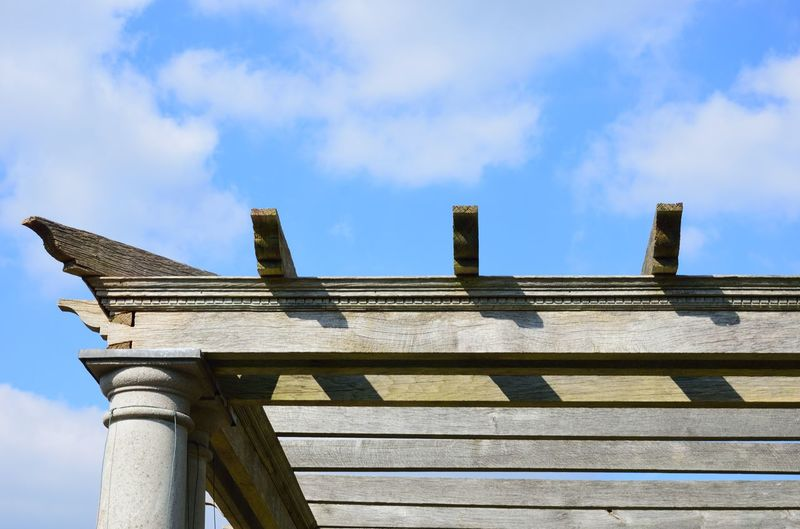 Detail of large outdoor Pergola Low Angle View Architecture Building Exterior Built Structure Pergola Detail Wooden Sky The Past Ancient No People Garden Outdoor Cloud - Sky Architectural Column Outdoors