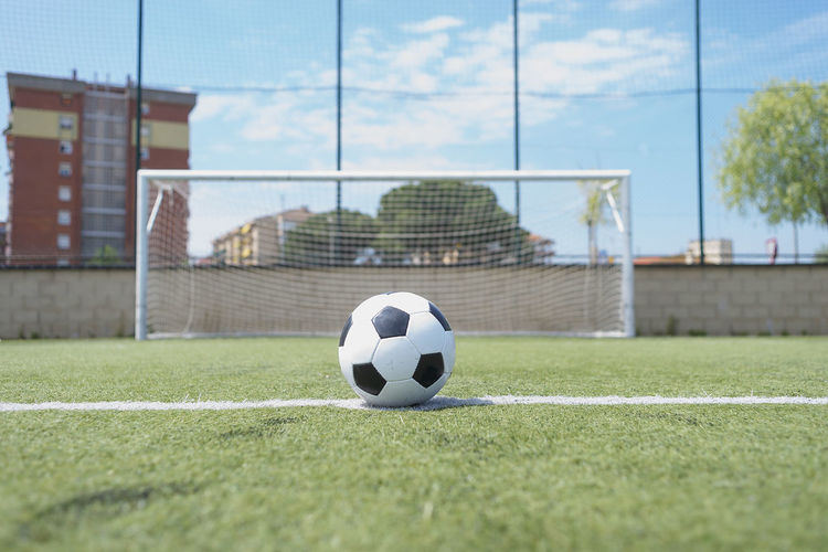 soccer ball on green grass field, penalty Absence Ball Close-up Day Focus On Foreground Football Grass Green Color Nature Net - Sports Equipment No People Outdoors Plant Soccer Soccer Ball Soccer Field Soccer Goal Sport Sports Equipment Surface Level Team Sport Turf