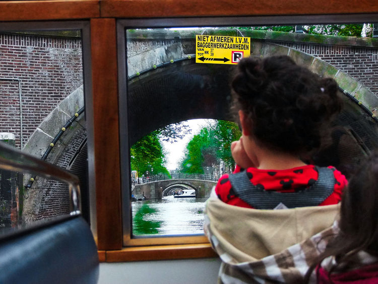 The unceasing curiosity of a child. A Child's Curiosity A Child's Perspective Amsterdam Amsterdam Canal Boat View Child Curiosity View From The Boat