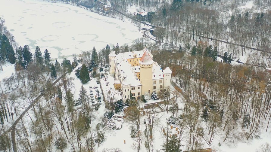 High angle view of trees by building during winter