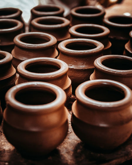 pots. Pattern Pattern, Texture, Shape And Form Clay Earthenware Business Finance And Industry Brown Workshop Close-up Pottery Terracotta Pot For Sale Molding A Shape Arrangement Display Repetition