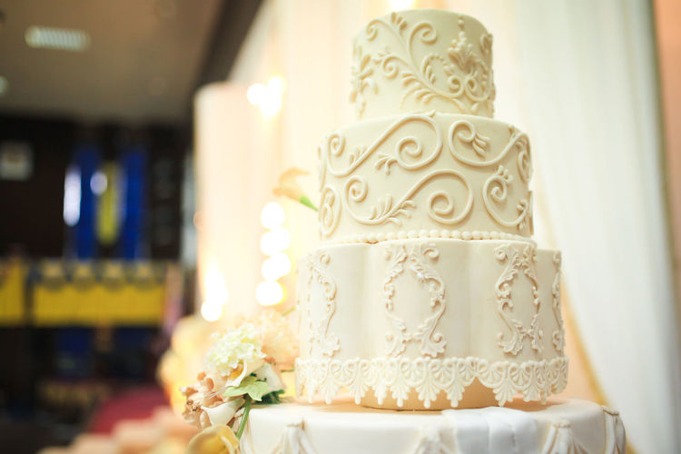 Close-up of wedding cake on table